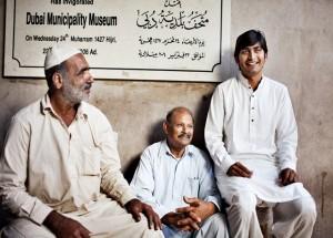 Culture_Old Dubai_Three men sitting and talking near Dubai Museum